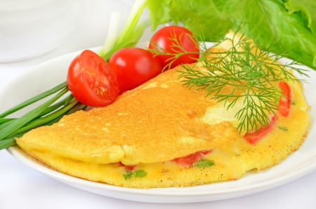 Omelette with herbs and vegetables on the plate photo