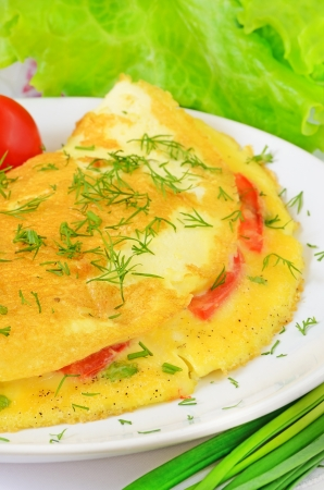 Omelet with herbs and vegetables on the plate photo
