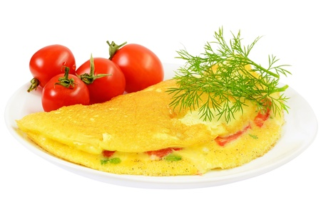 Omelet with herbs and vegetables on the plate isolated on white background photo