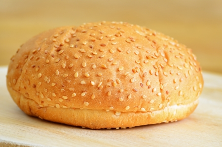 Burger bread on a wooden kitchen board photo