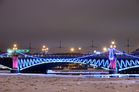 PETERSBURG, RUSSIA-JANUARY 5 Trinity bridge with Christmas illumination on January 5, 2013 in Petersburg, Rus  Bridge across the Neva river, built 1897-1903  It is 582 meters long and 23 6 meters wide