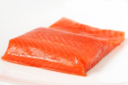Salted salmon fillet on the white plate photo