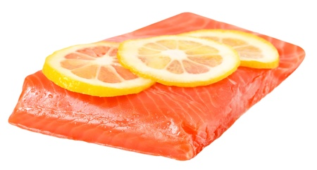 Salted salmon fillet and lemon slices isolated on white background photo