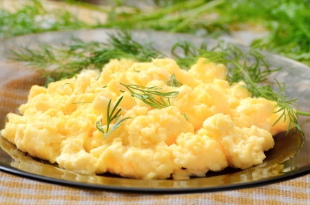 scrambled: Omelet with dill on the glass plate