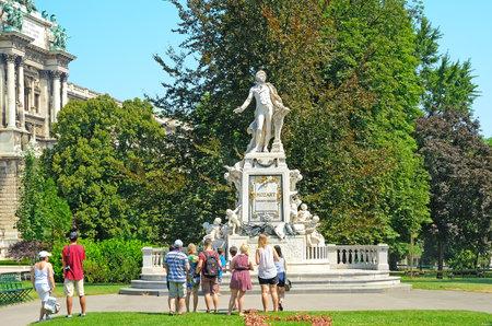 amadeus: VIENNA, AUSTRIA - JULY 28: Tourists visit the monument to Mozart on July 28, 2013 in Vienna, Austria. The Mozart monument in Vienna was built by the sculptor Viktor Tilgner in 1896.  Editorial