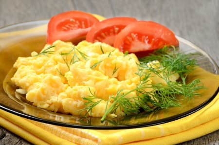 Omelet with herbs and vegetables on wooden table