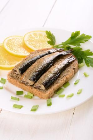 sprats: Sprats sandwiches on white plate