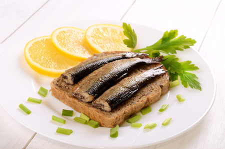 sprats: Sprats sandwiches on white plate