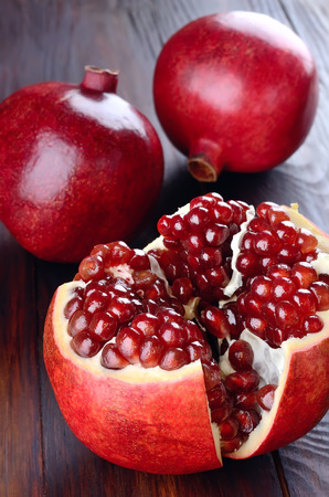 Pomegranate fruits on wooden table