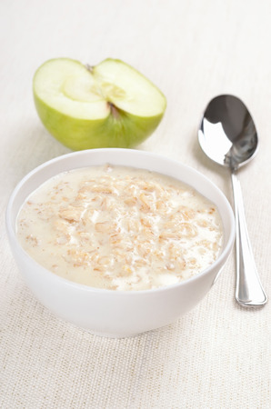 Oatmeal porridge in white bowl