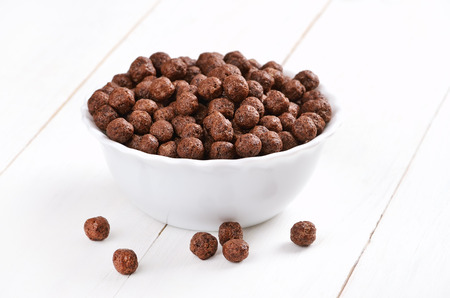 Cereal chocolate balls on white wooden table Stock Photo