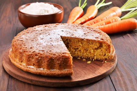 Carrot cake on wooden table Stock Photo - 31279965