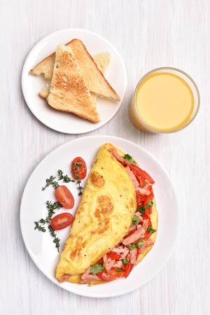 view top: Omelette with vegetables and ham, top view