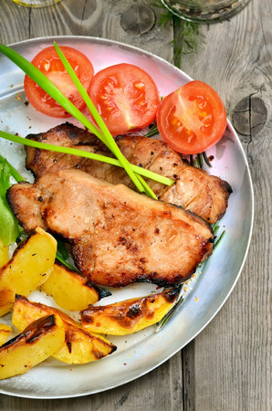 baked potatoes: Roasted steaks with baked potatoes and fresh vegetables on rustic table