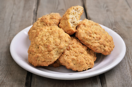 oatmeal cookies: Oatmeal cookies on rustic table, close up view