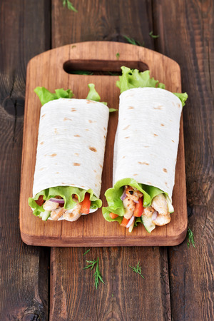 Wrap sandwiches with chicken meat and vegetables photo