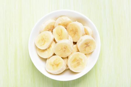 Fresh banana fruits in bowl, top view