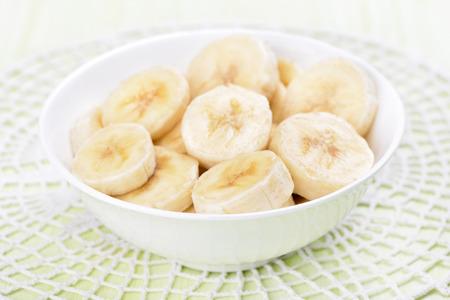 close up view: Sliced banana in bowl, close up view