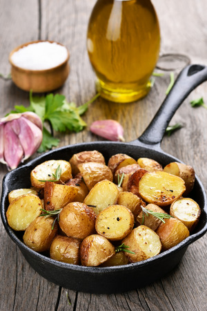 prepared potato: Baked potato in frying pan on rustic table