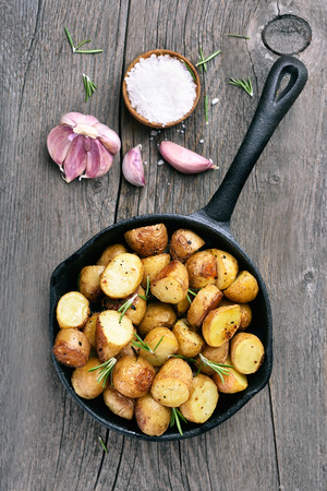 Roasted potato in frying pan, top view Stock Photo