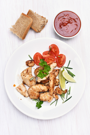 Chicken fillet and vegetable on white plate, top view Stock Photo