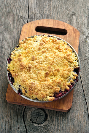 cherry pie: Plums crumble pie on cutting board, top view Stock Photo