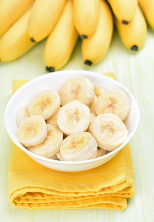 Banana slices in white bowl Stock Photo