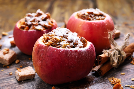 Stuffed apples with granola and honey, close up view, shallow depth of field