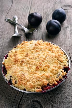 crumb: Plum crumb pie on wooden background Stock Photo