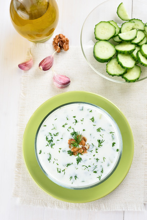 cold soup: Cold soup with yogurt and dill in bowl, top view
