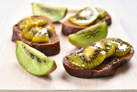 close up view: Kiwi marmalade on bread, close up view Stock Photo