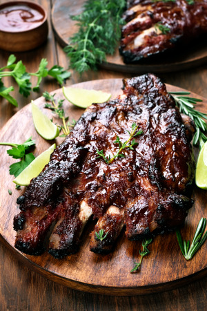 pork ribs: Barbecue pork ribs on wooden board, shallow depth of field