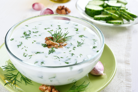Cold summer soup Tarator with yogurt, cucumbers, dill and walnut