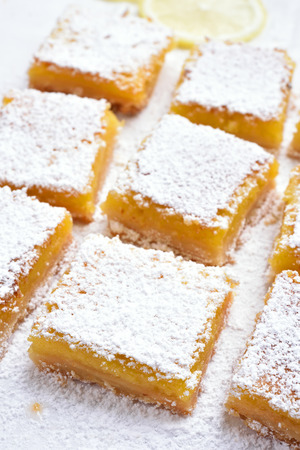 Dessert lemon bars over baking paper