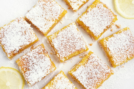 Baking lemon bars over baking paper, top view Stock Photo