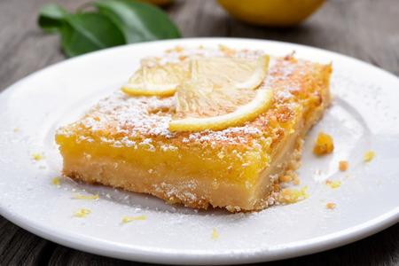 lemon pie: Lemon pie on white plate, close up view