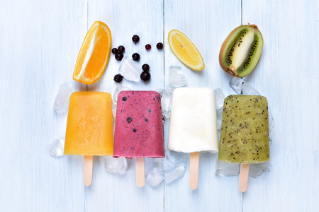 Homemade frozen ice cream popsicles from fruits, top view