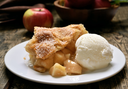 Piece of apple pie served with ice cream, fruit baking