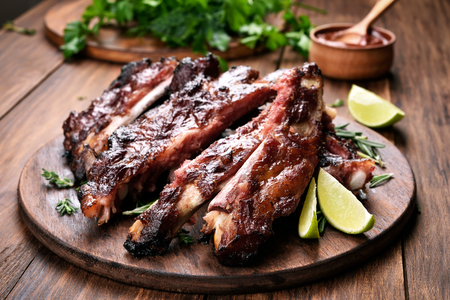 Grilled barbecue pork ribs on wooden board
