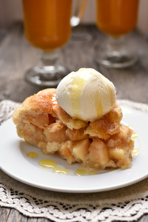 Piece of apple pie served with ice cream Stock Photo