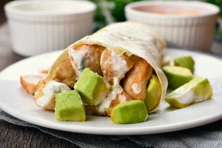 filled roll: Homemade chicken fajitas with avocado, close up view