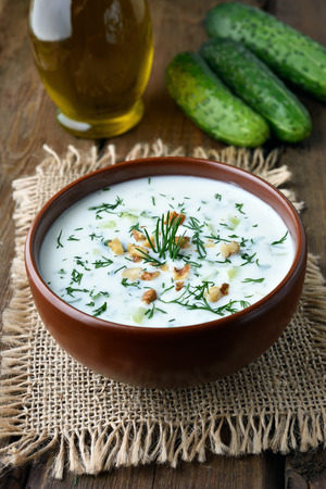 okroshka: Yoghurt cold soup with cucumbers, nuts and dill, healthy diet food