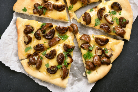 Slices of mushroom pizza, top view, close up Stock Photo