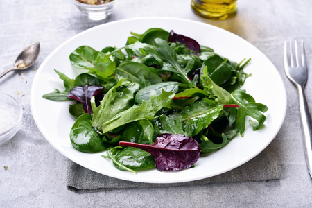Green salad with arugula, mesclun, spinach. Healthy food, close up view