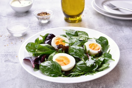 Green mix salad with eggs and greens. Healthy food.