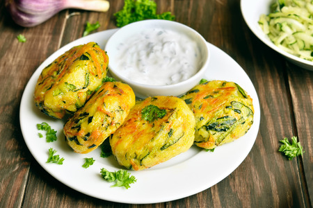 Vegetable cutlet from carrot, zucchini, potato with sauce. Healthy diet food. Close up view Stock Photo