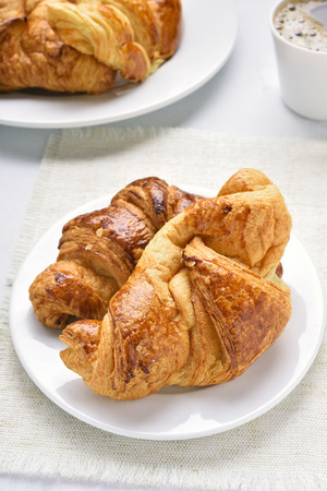 Hot croissants for a breakfast. Close up view