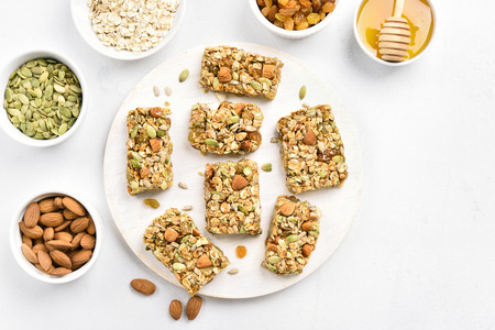Granola bar on white background. Healthy food for breakfast. Top view, flat lay Reklamní fotografie