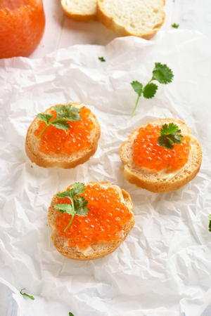 Tasty sandwiches with red caviar. Healthy delicious snack
