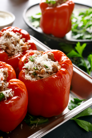Red bell peppers stuffed with minced meat, rice, onion, parmesan cheese. Tasty dish for dinner